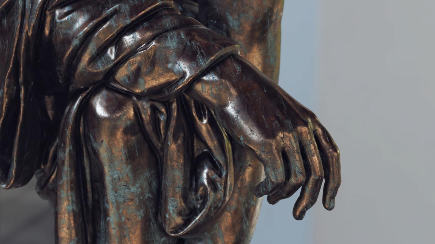 Hand of a bronze statue